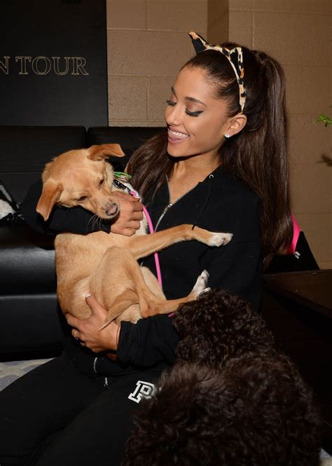 breeders in ny grande plays with dogs in new york hawtcelebs