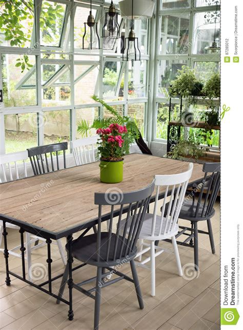 big w home decor white dining room with rustic table stock image
