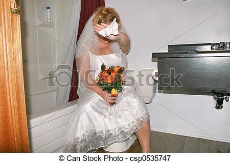 caught in the bathroom picture of going pee a bride caught in the bathroom csp0535747 search stock