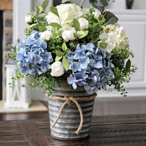 blue hydrangea flower arrangements stunning blue and white hydrangea centerpiece