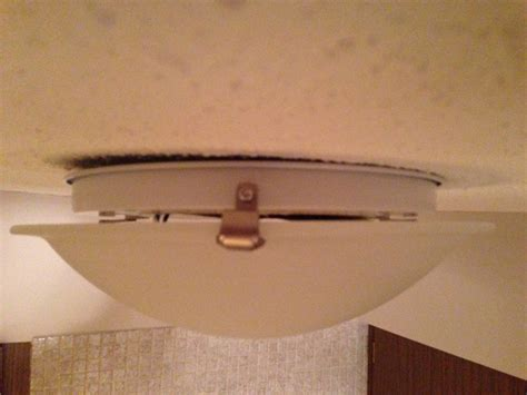 Changing A Bathroom Light Fixture Lighting How Can I Change The Bulb In This Three Clawed Ceiling Mounted Dome Light Fixture
