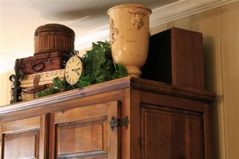 Top Of Armoire Decor by Great Idea For Decorating The Empty Space Above An Armoire