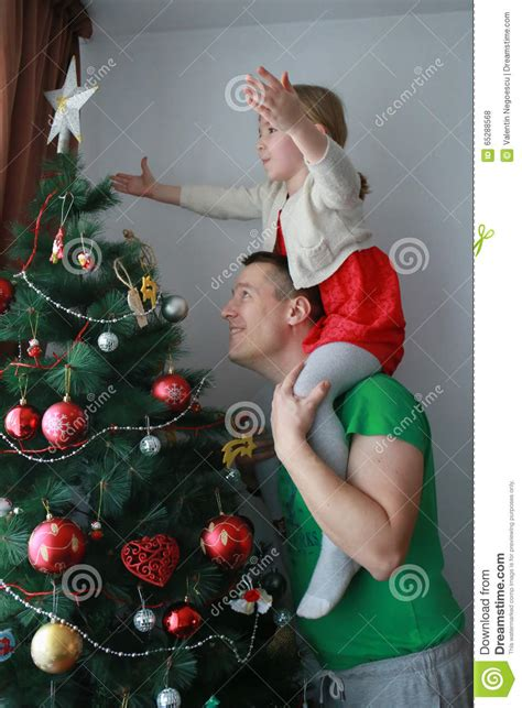 howtoput a star on a christmastree the put the on top of the tree stock photo image 65288568
