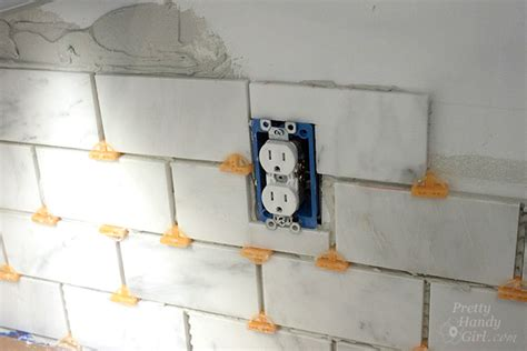 how to do backsplash around outlets how to tile a backsplash part 1 tile setting pretty