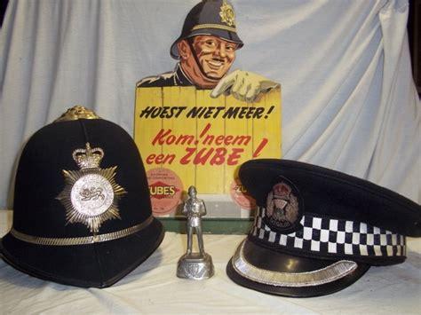 Swiss Navy 8324 helmen uniformen emblemen curiosa medailles