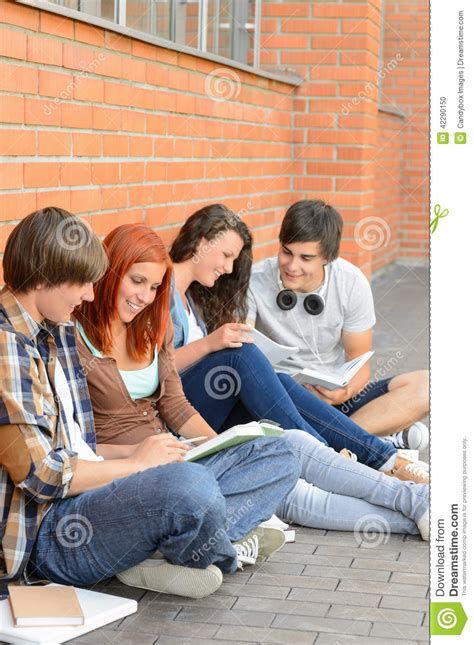 Reading Friends by Students Friends Sitting On Ground Outside Cus Stock