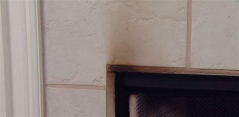 how to clean soot and smoke on a fireplace surround