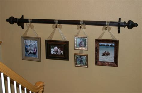 where to hang curtain rod use ribbon to hang frames from a curtain rod great idea