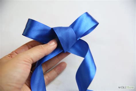 How To Make A Ribbon Bow Out Of Paper - make a bow out of a ribbon step 10 version 2 jpg