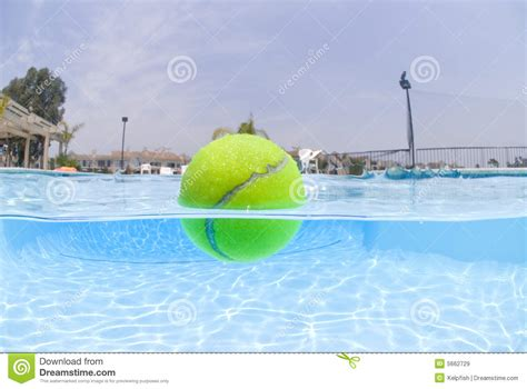 Split Level Plans by Tennis Ball Floating In Pool Royalty Free Stock Images