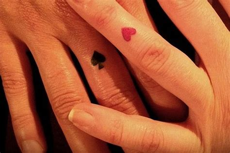 couple ring tattoos give up your engagement ring for wedding ring tattoos