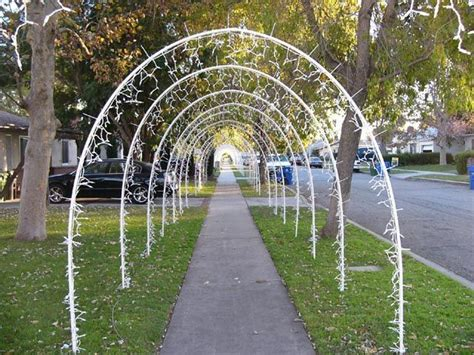 how to build a christmas arch lighted arches made out of 1 2 inch pvc pipe held in place by 3 foot rebar stakes each arch is