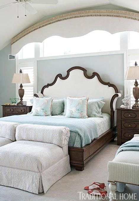 soft traditional master bedroom the tailored pillow soft blues contrast with chocolatey browns in this master