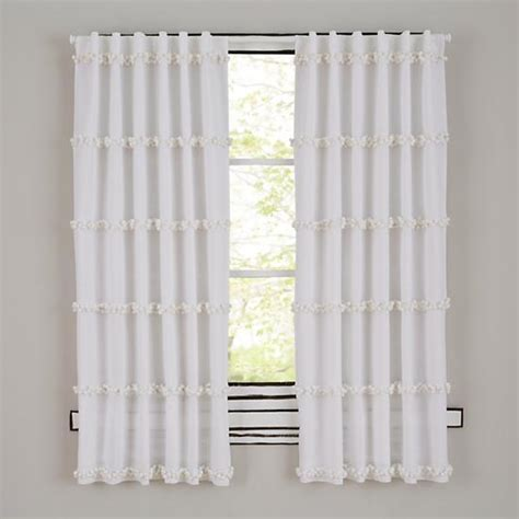 white curtains with pom poms poms square white quilt