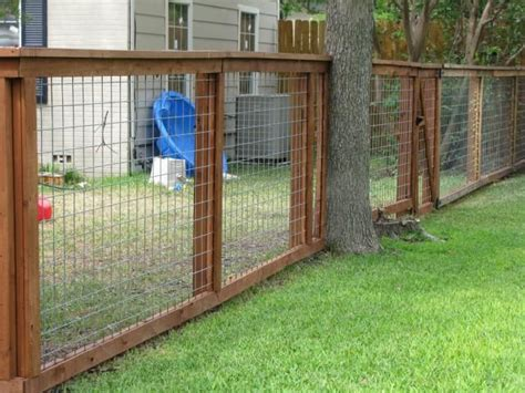 backyard dog fence showing construction of wood hog panel fence fencing