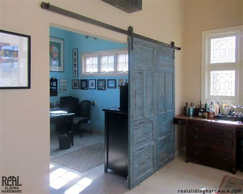 Blue Barn Doors This Blue Barn Door Separates An Office Space And Entertainment Room Doors