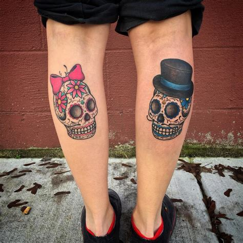 day of the dead female amp male sugar skulls tattoo by nic