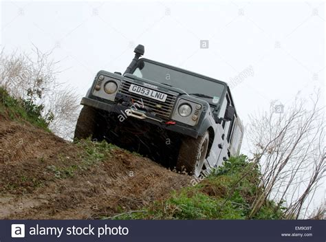 land rover mud land rover defender driving road in mud and