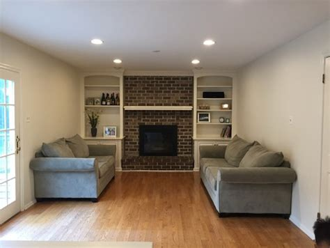 long narrow living room with fireplace in center long narrow family room