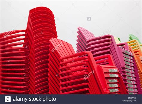 Colorful Adirondack Chairs by Stack Of Colorful Plastic Adirondack Chairs Stock Photo