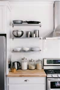 white kitchen with stainless steel fridge beside ikea ekby mossby ekby bj 196 rnum wall shelves in