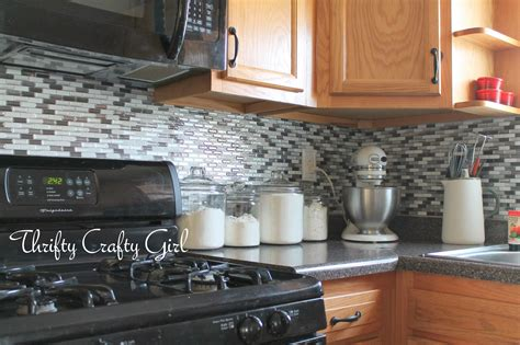 how to put up tile backsplash in kitchen thrifty crafty easy kitchen backsplash with smart tiles