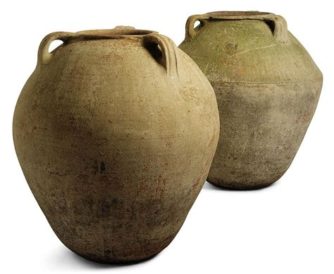 Two With Olive two terracotta olive jars probably southern turkey 19th