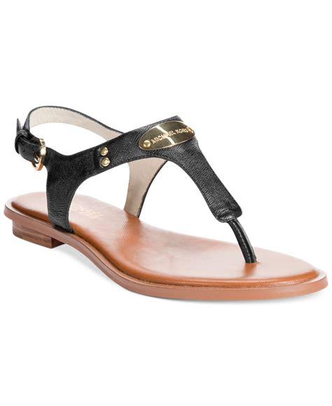 mk sandals michael kors mk plate flat sandals in black lyst