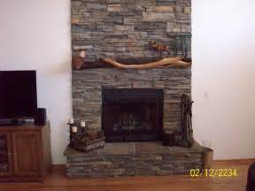 Rock Fireplace Pictures fireplace mantle this stone covered fireplace adds a unique touch to