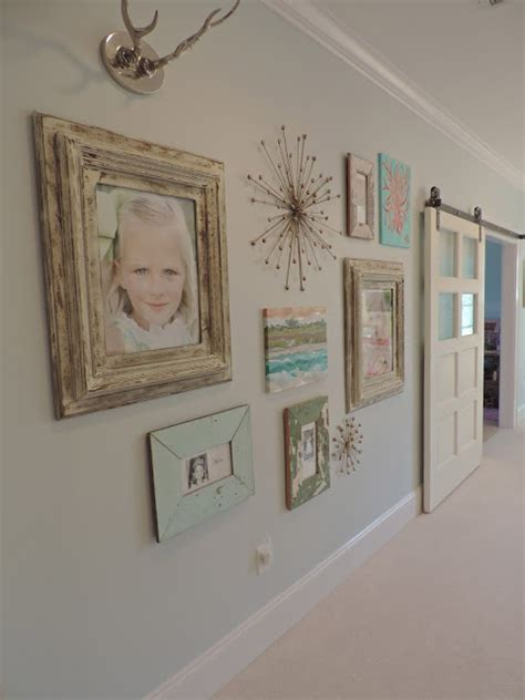 a gallery wall complete with family photos and edgy