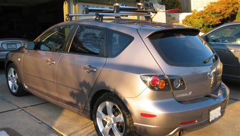 mazda 3 snowboard rack the best mazda 3 roof racks for skis bikes kayaks and boxes