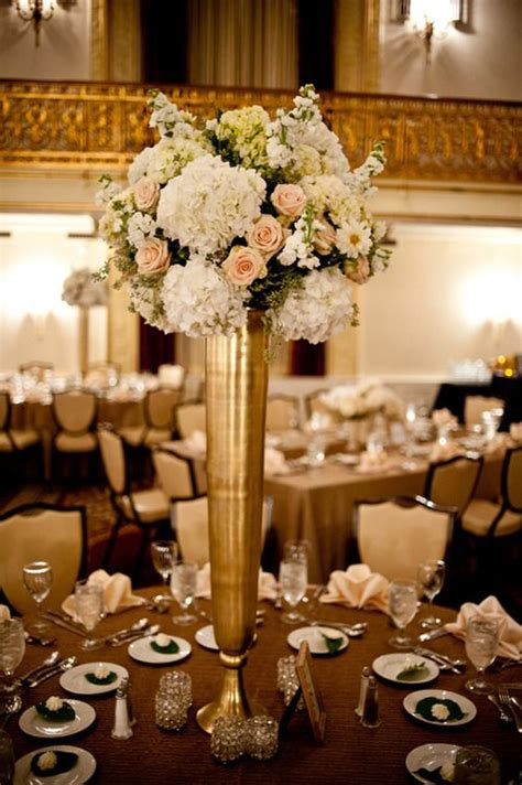 gold centerpieces gold ivory reception wedding flowers wedding decor