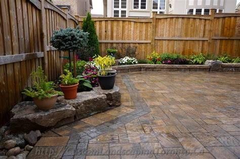 backyard interlocking project with flower beds toronto landscaping design interlock driveway