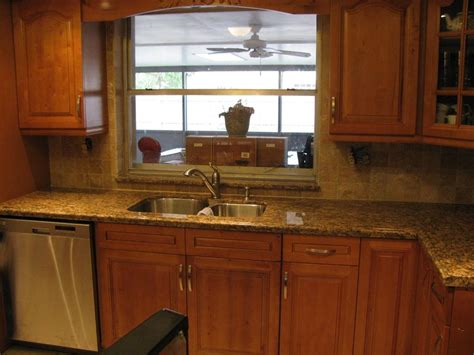 Kitchen Countertops And Backsplashes by A Beautifully Installed Kitchen With Tumbled Stone Backsplash