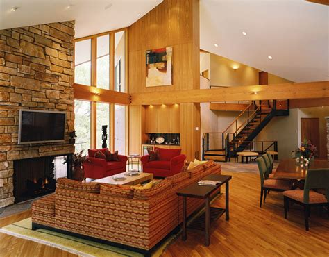 vaulted living room vaulted living room with stone fireplace and beams