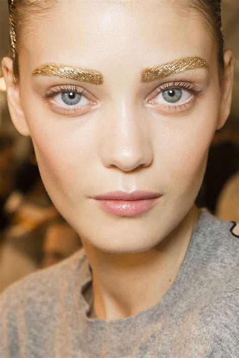 Makeup Christian pfw backstage makeup by pat mcgrath ss2014 gold eyebrows pat