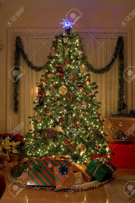 christmas tree with presents and lights