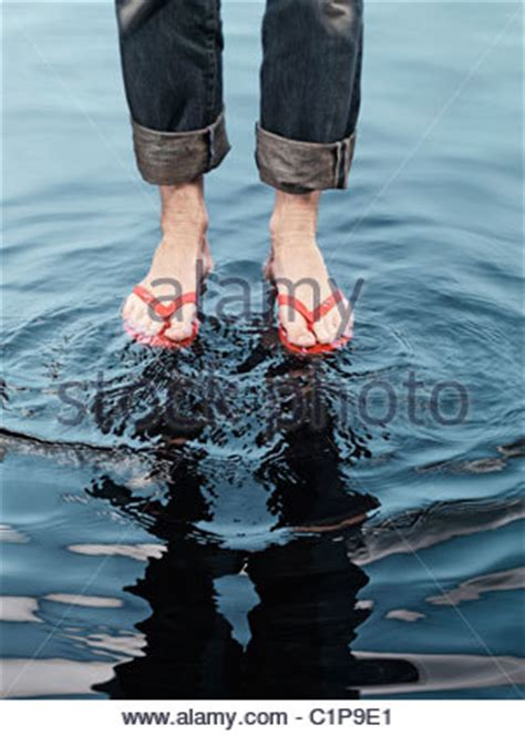 fluid in feet after c section the bare feet of a man wearing jeans with rolled up legs