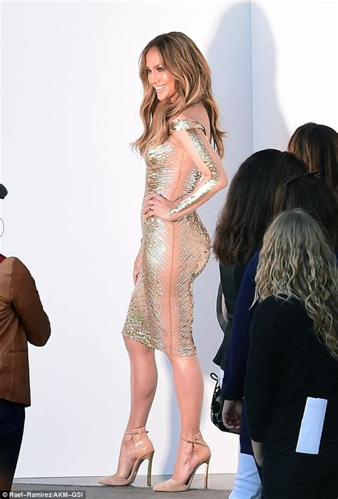 jennifer lopez steals the spotlight in a see through jennifer lopez displays her famous curves in shimmering