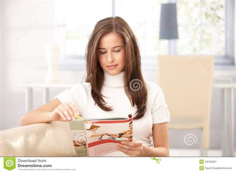 off the couch magazine woman reading magazine at home stock image image 18760351