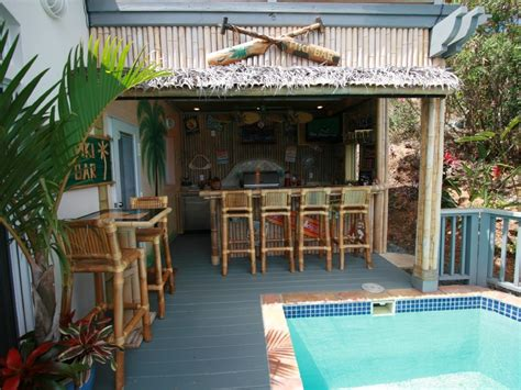 tiki bar and outdoor kitchen backyard paradise