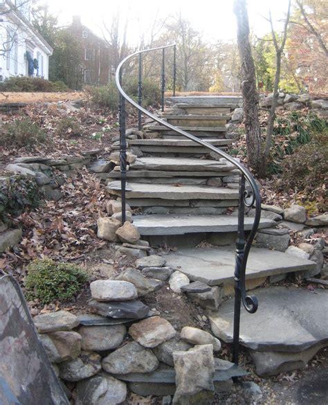 garden banister decorative garden ironwork railing on stone steps with