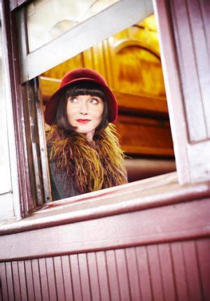 does essie davis wear a wig for miss fisher the rules of tv in 2012