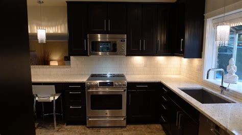 ikea ramsjo black brown with white subway tile backsplash