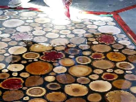 spreading the epoxy sanded wooden disks