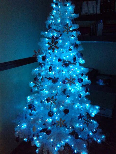 white tree with lights white tree with blue lights holidays