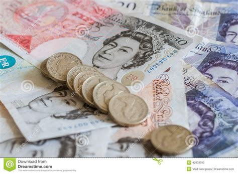 currency gbp money pounds sterling banknotes and coins