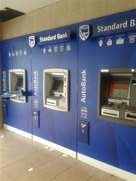 bank machine near me are looking for 17 suspects who robbed standard