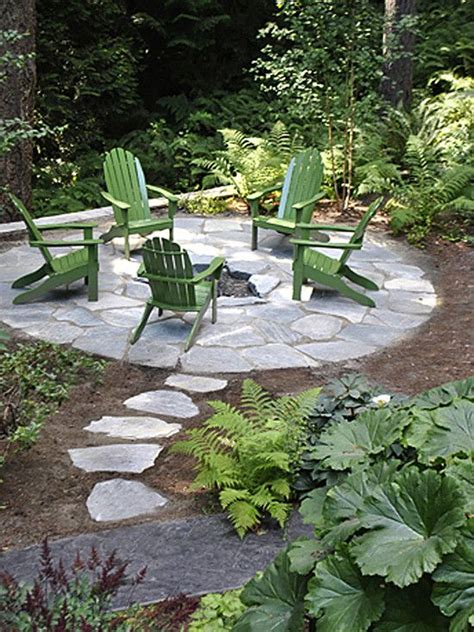 landscape design pits and green chairs on