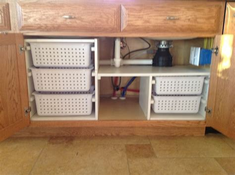 under kitchen sink organizing ideas under kitchen sink organization my husband built for